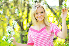 Beautiful blond woman smiling and having fun. Young beautiful blond woman smiling and having fun outdoors - Closeup royalty free stock photography