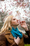 Beautiful blond woman at spring Royalty Free Stock Photos