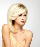 Beautiful blond woman with style hairstyle Stock Images