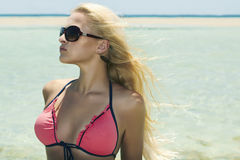 Beautiful blond woman in sunglasses on beach.paradise island Royalty Free Stock Photo