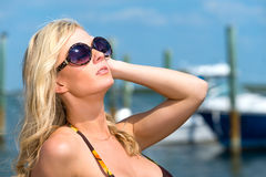 Woman enjoys the summer with boats behind. Royalty Free Stock Image