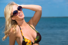 Beautiful blond woman enjoying the seaside Stock Photos