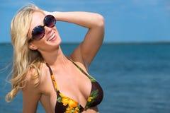 Beautiful blond woman enjoying the seaside Stock Photos