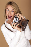 Beautiful blond woman taking photographs. Stock Image