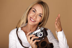 Beautiful blond woman taking photographs. Royalty Free Stock Photography