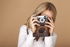 Beautiful blond woman taking photographs. Stock Images