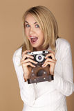 Beautiful blond woman taking photographs. Royalty Free Stock Photos
