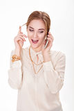 Beautiful blond woman talking on the phone and plays with  hair. Stock Image