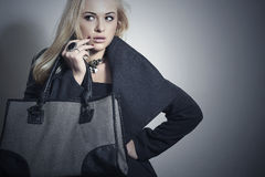 Beautiful Blond Woman in Topcoat.Girl with Handbag Stock Photos