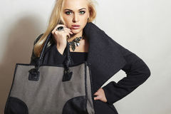 Beautiful Blond Woman in Topcoat.Girl with Handbag Royalty Free Stock Photo