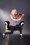 Beautiful blond woman with violin Royalty Free Stock Images