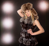 Beautiful blond woman wearing fur coat Royalty Free Stock Image