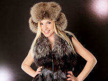 Beautiful blond woman wearing fur coat Stock Photo