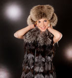Beautiful blond woman wearing fur coat. Portrait of a beautiful blond woman wearing fur coat and hat Royalty Free Stock Photos