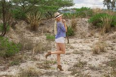 Beautiful blond woman wearing the hat outdoors in the prairie stock photography