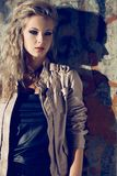 Beautiful blond woman wearing leather jacket Royalty Free Stock Images