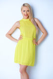 Beautiful blond woman wearing lemon dress Royalty Free Stock Image