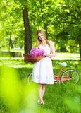 Beautiful blond woman wearing a nice dress having fun in park wi Royalty Free Stock Photo