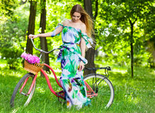 Beautiful blond woman wearing a nice dress having fun in park wi Royalty Free Stock Images