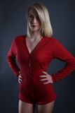 Beautiful blond woman wearing a red bodysuit Royalty Free Stock Image
