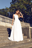 Beautiful blond woman wears wedding dress,posing beside antic villa Royalty Free Stock Photos
