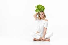 Beautiful blond woman in white blouse holding fresh green salad on white background. Health and Diet Stock Images
