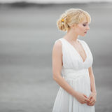 Beautiful blond woman in white dress stock photography