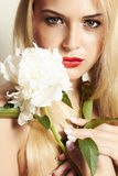 Beautiful blond woman with white flower Royalty Free Stock Photos