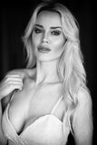 Beautiful Blond Woman in White Gown Stock Photos