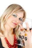 Beautiful blond woman with wine and jewelry Royalty Free Stock Photo
