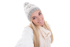 Beautiful blond woman in winter clothes taking selfie photo isol Stock Images