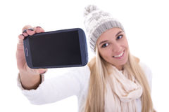 Beautiful blond woman in winter clothes taking selfie photo with Royalty Free Stock Photo