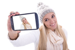 Beautiful blond woman in winter clothes taking selfie photo with Royalty Free Stock Image