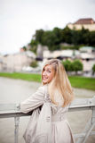 Beautiful blond woman in a winter raincoat Stock Photo