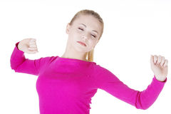 Beautiful blond woman yawning and stretching Stock Images