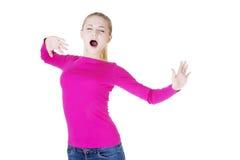 Beautiful blond woman yawning and stretching Royalty Free Stock Image