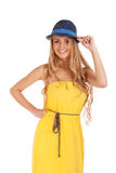 Beautiful blond woman in yellow dress and a hat Stock Image