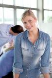 Beautiful blond working woman Royalty Free Stock Image