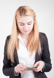 Beautiful blond young  businesswoman counting her banknotes Royalty Free Stock Photos