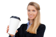 Beautiful blond young businesswoman holding a cup of coffee Stock Image