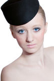 Beautiful blond young girl with blue eyes isolated. Beautiful young blond girl with blue eyes and black bonnet isolated on white stock image