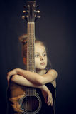 Beautiful Blond Young Girl Hug A Guitar Stock Images
