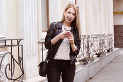 Beautiful blond young hipster girl in leather jacket Royalty Free Stock Photo