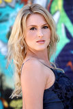 Beautiful blond young woman. Portrait of a gorgeous blond young woman against a wall of graffiti Royalty Free Stock Photos