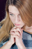 Beautiful blond young woman in contemplation Stock Image