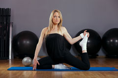 Beautiful Blond Young Woman Doing Pilates in Gym Stock Photos