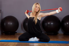 Beautiful Blond Young Woman Doing Pilates in Gym Royalty Free Stock Image
