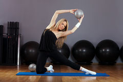 Beautiful Blond Young Woman Doing Pilates in Gym Royalty Free Stock Photo
