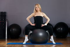 Beautiful Blond Young Woman Doing Pilates in Gym Royalty Free Stock Images