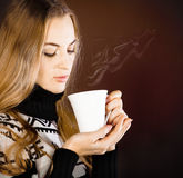 Beautiful blond young woman drinking coffee Royalty Free Stock Photos